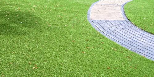 Path in garden next to artificial grass