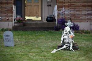 A picture of a lawn skeleton and a fake grave stone